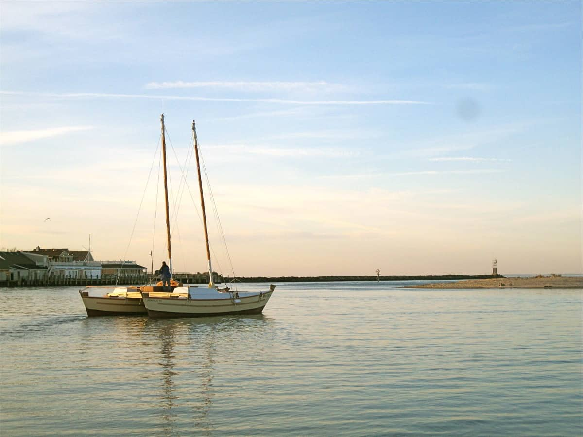 The charter catamaran Mon Tiki glides through Montauk Harbor on her way to Block Island Sound