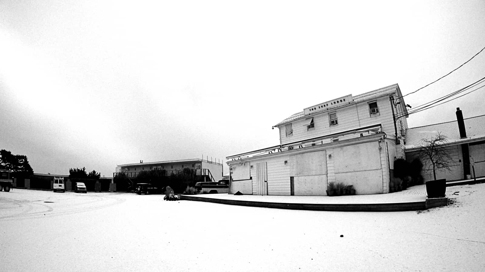 White snow covers white sand in the Surf Lodge parking lot, Montauk NY, photo by Sailing Montauk