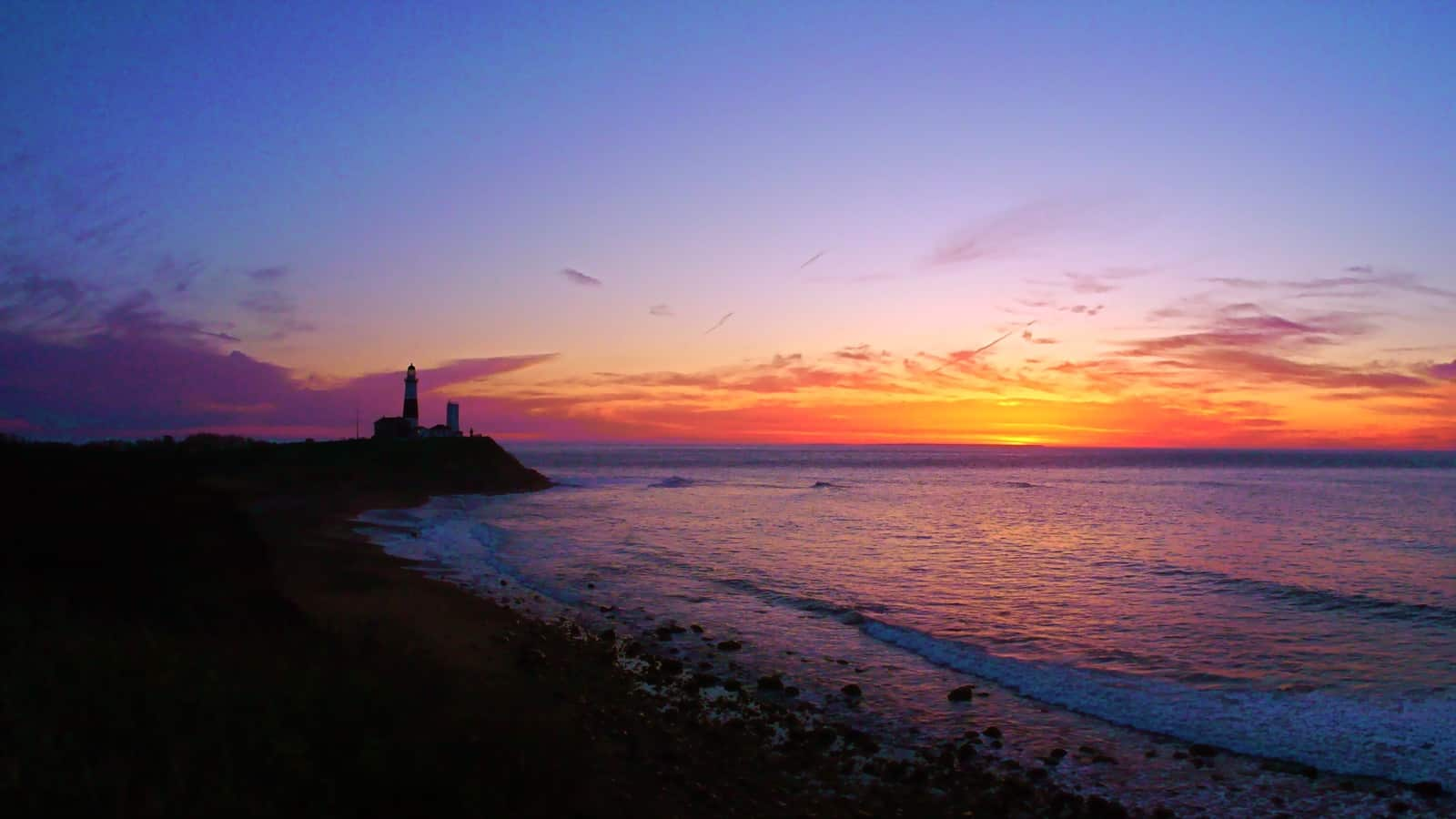 Sunrise over Block Island as seen from Montauk Point, April 30, Montauk NY, photo by Sailing Montauk