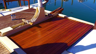 Oiling Mon Tiki's Hardword Deck, photo by Sailing Montauk