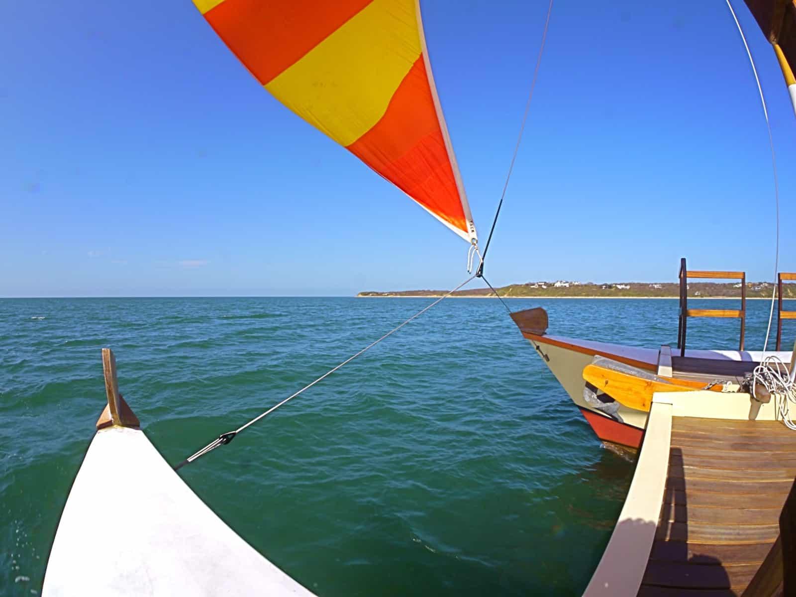 The charter sailing catamaran Mon Tiki sailing past Culloden Point, Montauk NY, photo by Sailing Montauk