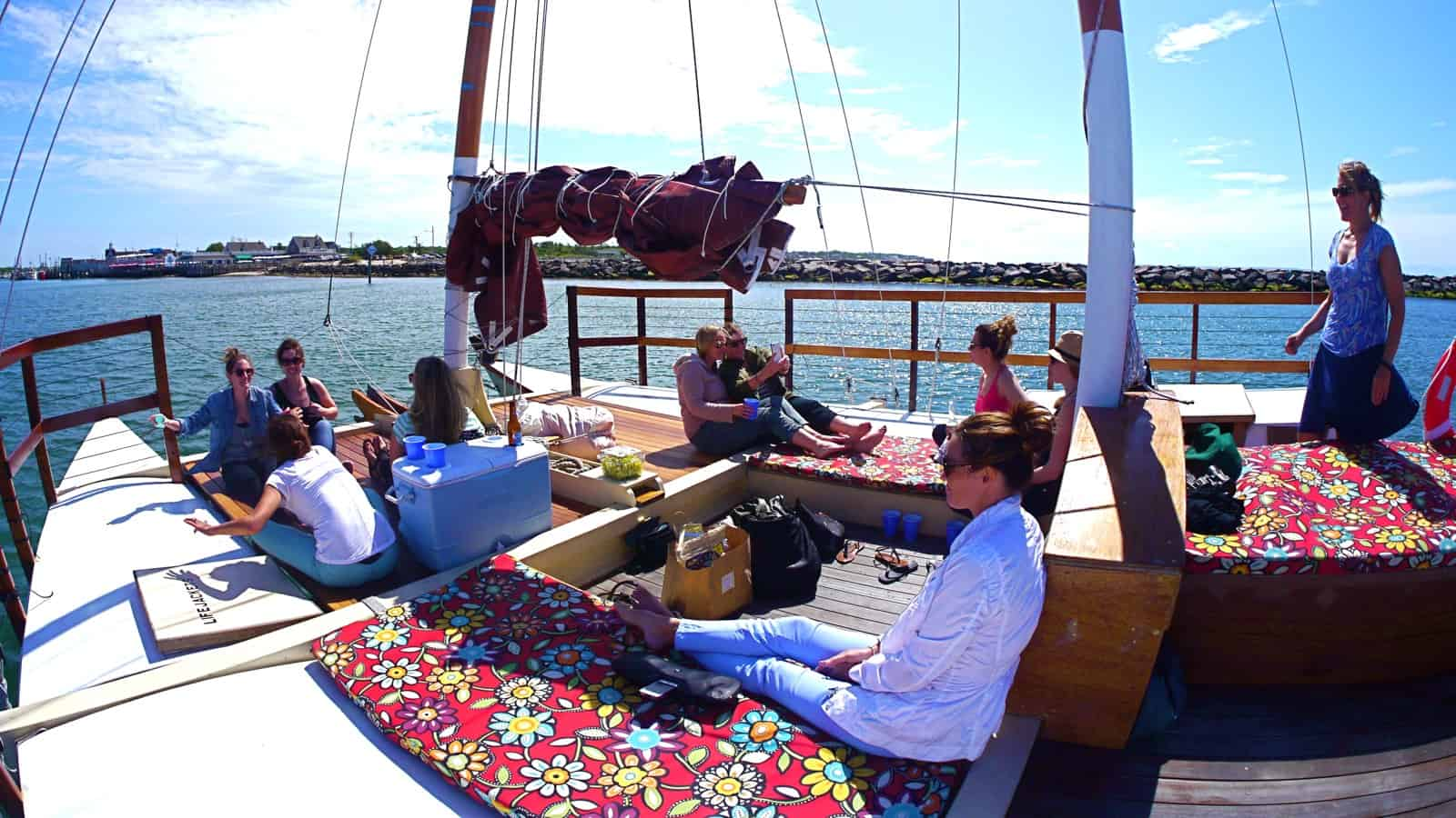 A bachelorette party on the charter catamaran Mon Tiki, coming through Montauk Harbor inlet, photo by Sailing Montauk