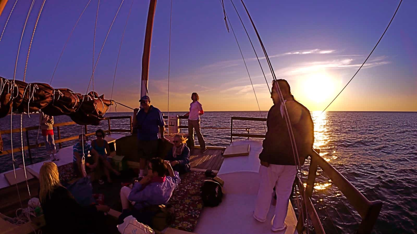 The sun settles on the western horizon on a sunset cruse on the charter catamaran Mon Tiki, photo by Sailing Montauk