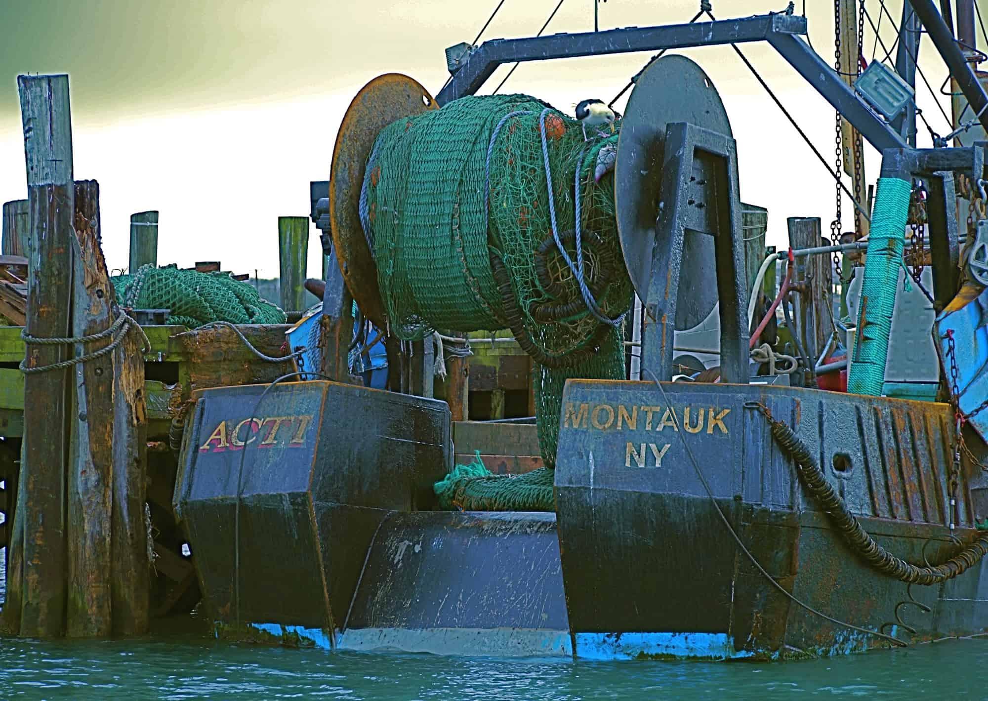 F/V ACT I at town dock in Montauk Harbor, photographed from the charter sailing catamaran MON TIKI
