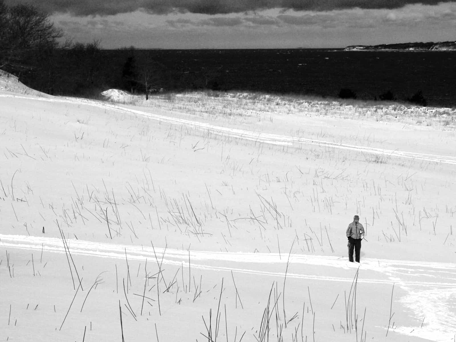 A lone figure, Eddie Ecker Park on Fort Pond Bay, Montauk NY, photo by Sailing Montauk