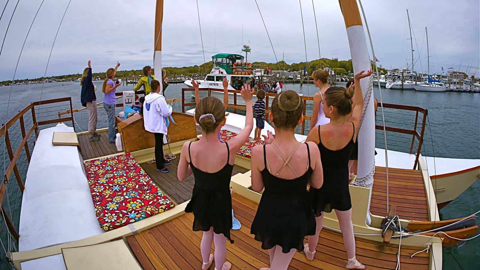 out-take from yesterday's HBTS photoshoot:  The Susie E II, piloted by Captain Burt Prince passes the charter sailing catamaran Mon Tiki, with Burt's wife Sharon, dancing daughters Sam and Jessica, and son Justin aboard. Photo by Sailing Montauk