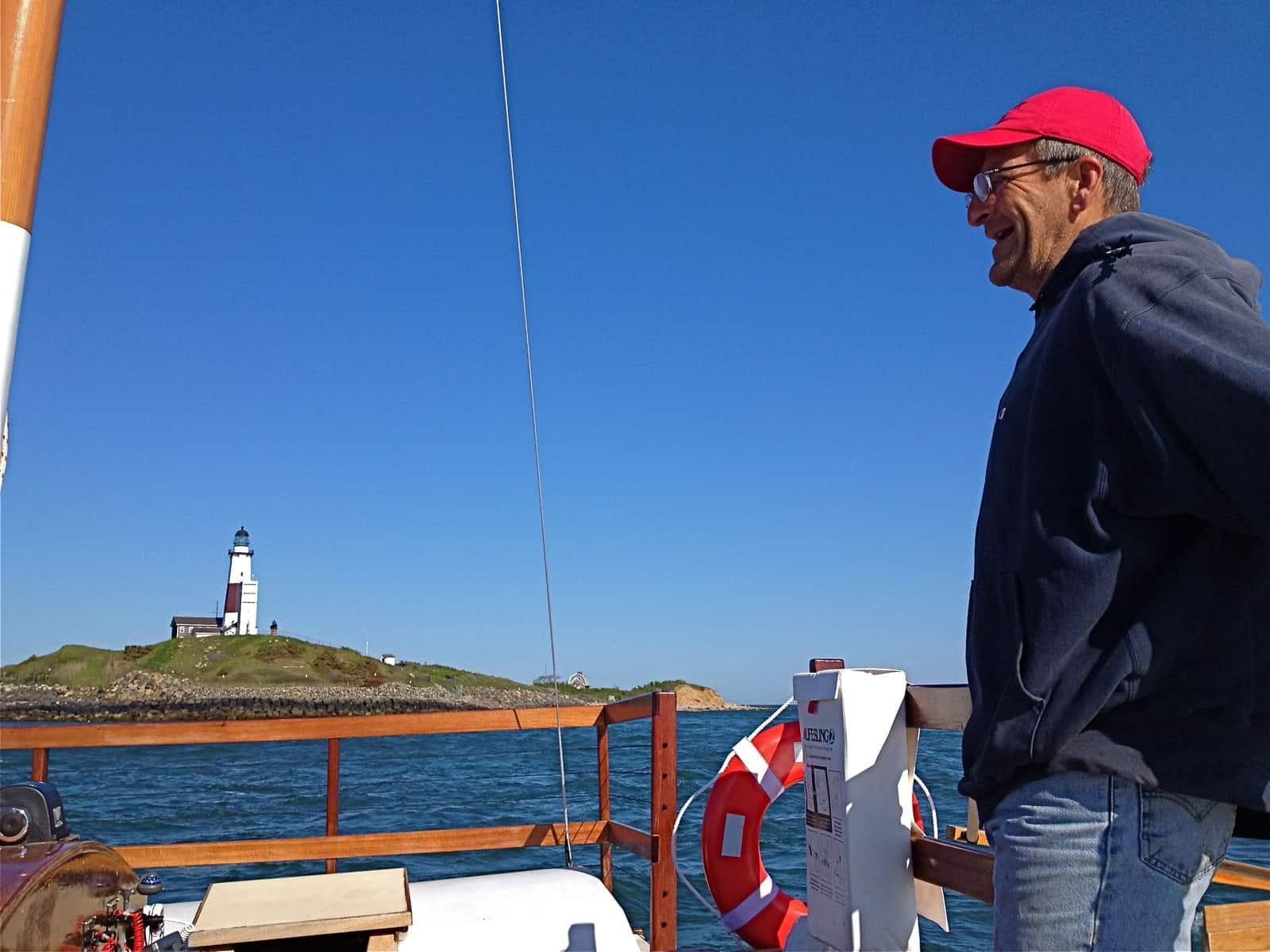 Dave Rutkowski pilots the charter sailing catamaran MON TIKI around Montauk Point, Memorial Day 2013, Montauk NY, photo by Sailing Montauk