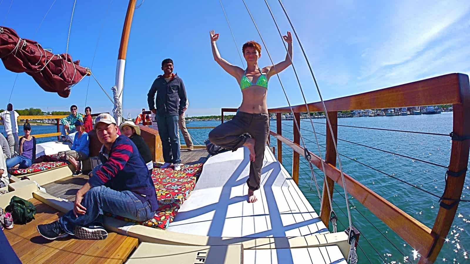 A Googler does yoga on the charter catamaran Mon Tiki sailing though Montauk Harbor, photo by Sailing Montauk