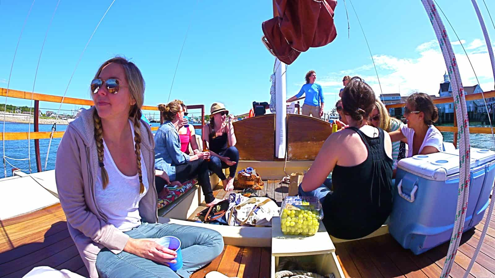Amelia at the helm during a bachelorette party on the charter catamaran Mon Tiki, photo by Sailing Montauk