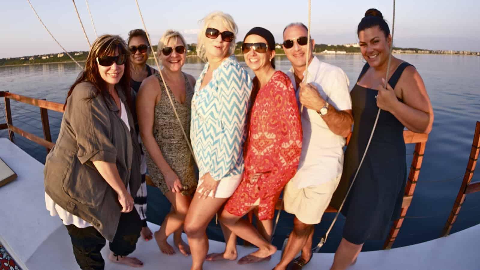 Group portrait of the Sephora team at the rail of the catamaran Mon Tiki, photo by Sailing Montauk