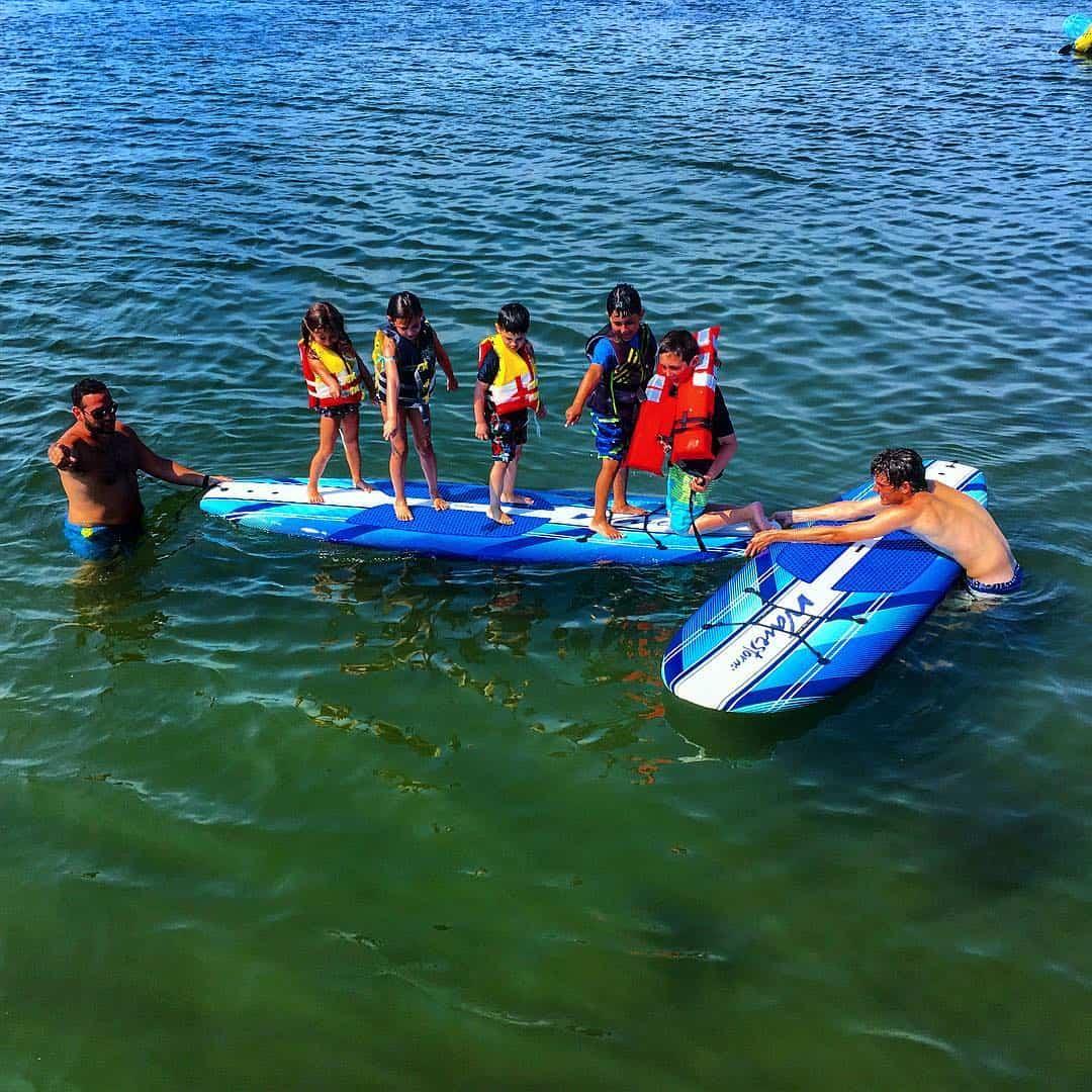 The kids spot a fish on a Mon Tiki family swim outing