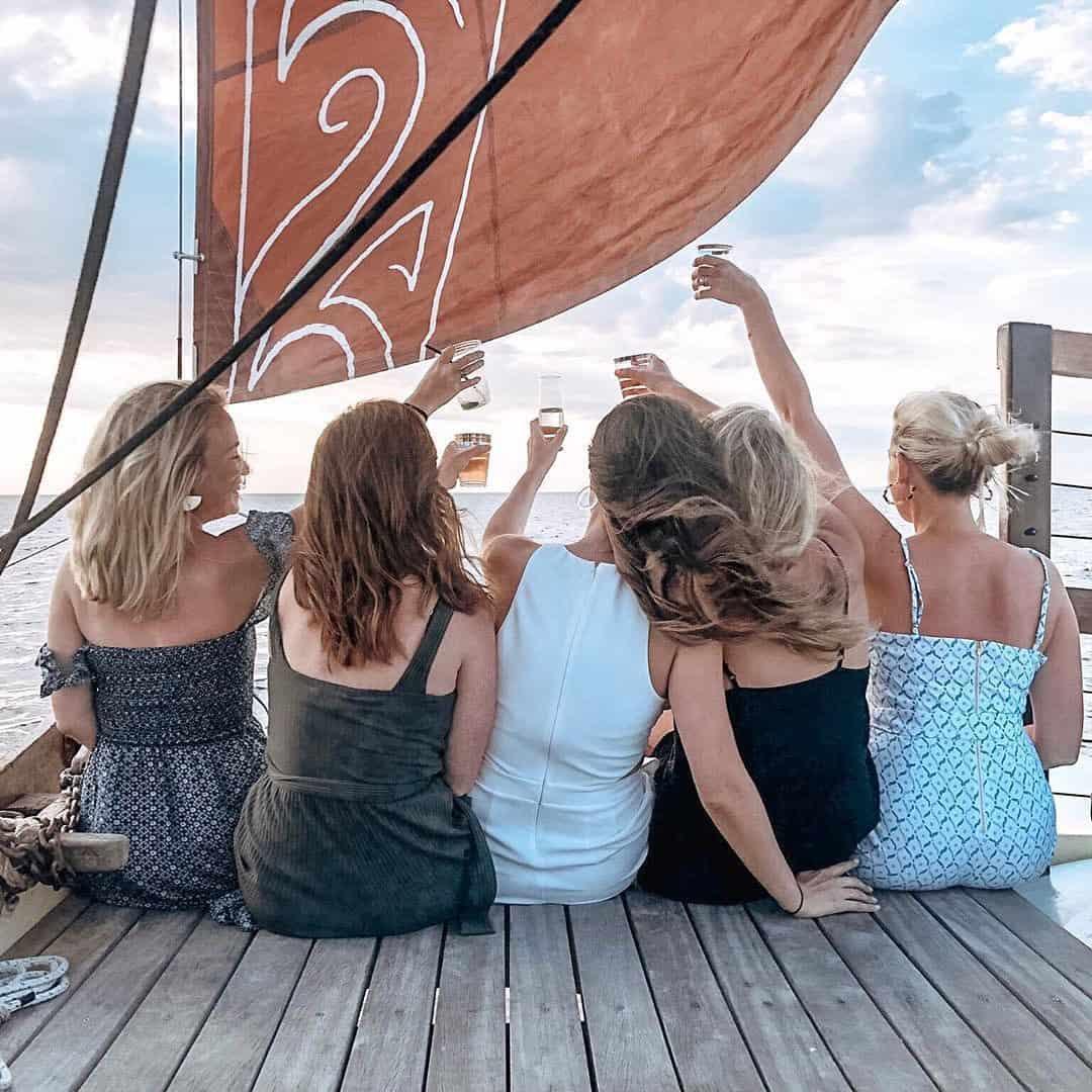 Friends celebrate on board Mon Tiki