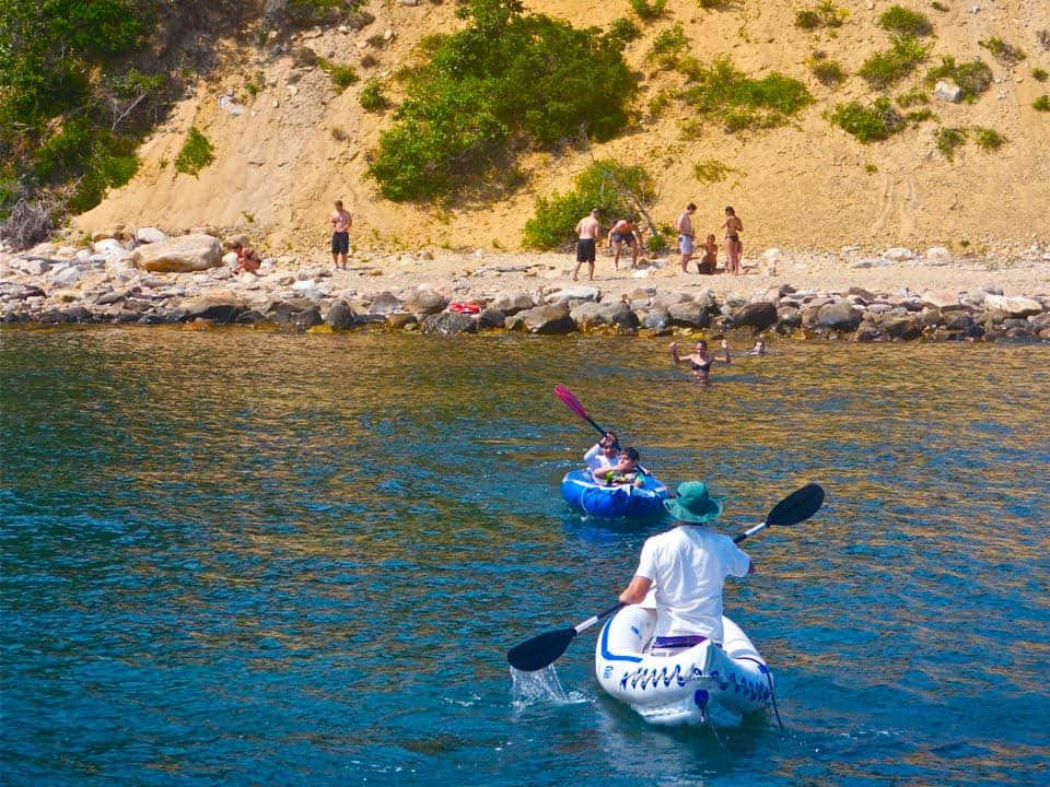 Paddling to shore in Fort Pond Bay